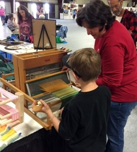 Young folks loved trying their hands at weaving