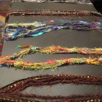 Scarves created from designer yarns
