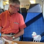 Alice on the train to Passau, Germany conversing with a friend.