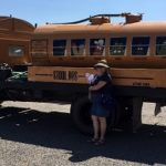 Alice and Jane enjoying the July 4th parade in Quemado New Mexico. Yes, the Stool Bus is a septic dipping truck.