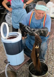 Ric spinning out dyed fibers.